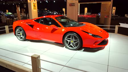 bélgica : BRUSSELS, BELGIUM - JANUARY 8, 2020: Ferrari F8 Tributo Italian mid-engine sports car in red on display at Brussels Expo. Handheld gimbal shot around the car.