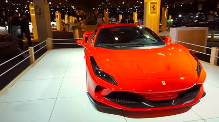 ferrari : BRUSSELS, BELGIUM - JANUARY 8, 2020: Ferrari F8 Tributo Italian mid-engine sports car in red on display at Brussels Expo. Handheld gimbal shot around the car.