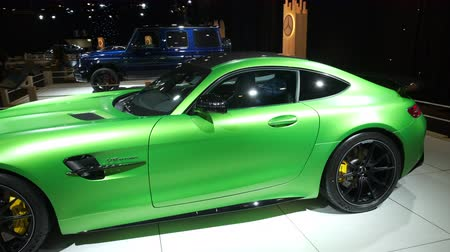 gt : BRUSSELS, BELGIUM - JANUARY 8, 2020: Mercedes-AMG GT R Coupé sports car on display at Brussels Expo. Handheld gimbal shot.