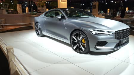 melez : BRUSSELS, BELGIUM - JANUARY 8, 2020: Polestar 1 hybrid sports car coupe in matte grey on display at Brussels Expo. Polestar is the performance company and brand of Volvo Cars. Handheld gimbal shot.