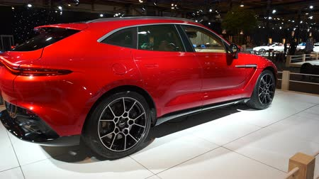 tudo : BRUSSELS, BELGIUM - JANUARY 8, 2020: Aston Martin DBX mid-sized, front-engine, all-wheel drive luxury crossover SUV on display at Brussels Expo. Handheld gimbal shot around the car.
