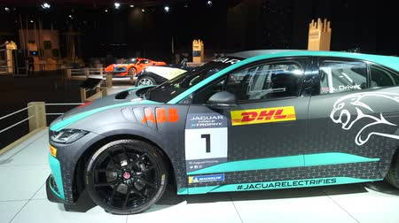 melez : BRUSSELS, BELGIUM - JANUARY 9, 2020: Jaguar I-PACE eTROPHY (I-PACE racecar) battery-electric crossover SUV on display at Brussels Expo Stok Video