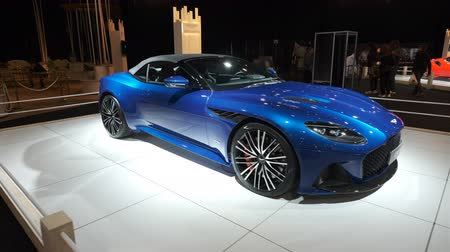 belgie : BRUSSELS, BELGIUM - JANUARY 8, 2020: Aston Martin DBS Superleggera Volante convertible sports car on display at Brussels Expo. Handheld gimbal shot.