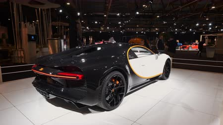 super car : BRUSSELS, BELGIUM - JANUARY 8, 2020: Bugatti Chiron Sport mid-engined W16 engine exclusive hypercar on display at Brussels Expo Stock Footage