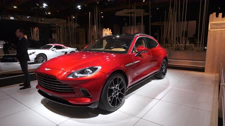 BRUSSELS, BELGIUM - JANUARY 8, 2020: Aston Martin DBX mid-sized, front-engine, all-wheel drive luxury crossover SUV on display at Brussels Expo. Handheld gimbal shot around the car.