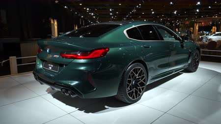 BRUSSELS, BELGIUM - JANUARY 8: BMW 8 Series M850i xDrive Gran Coupe fastback on display at Brussels Expo. Handheld gimbal shot. Стоковые видеозаписи