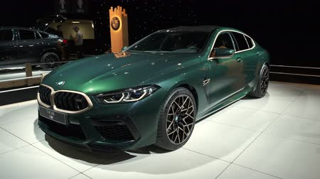 BRUSSELS, BELGIUM - JANUARY 8, 2020: BMW 8 Series M850i xDrive Gran Coupe fastback on display at Brussels Expo. Upwards zoom in clip.