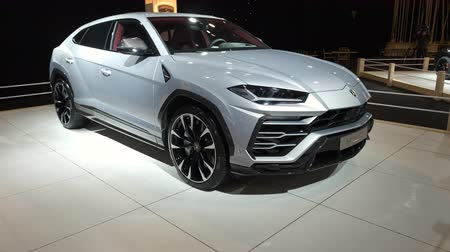 BRUSSELS, BELGIUM - JANUARY 8, 2020:  Lamborghini Urus luxury performance SUV car on display at Brussels Expo. Handheld gimbal shot.