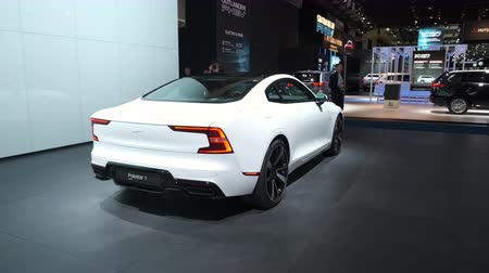 BRUSSELS, BELGIUM - JANUARY 8, 2020: Polestar 1 hybrid sports car coupe in white on display at Brussels Expo. Polestar is the performance company and brand of Volvo Cars. Handheld gimbal shot around t