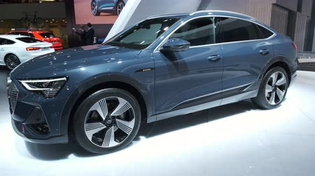BRUSSELS, BELGIUM - JANUARY 9, 2020: Audi e-tron Sportback full electric luxury crossover SUV car on display at Brussels Expo. Handheld gimbal shot.