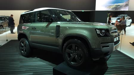 BRUSSELS, BELGIUM - JANUARY 9, 2020: Land Rover Defender 90 off-road 4x4 vehicle on display at Brussels Expo. Handheld gimbal shot around the car.