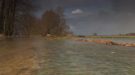 torrential rain : Water running over the floodplains of the river IJssel during flooding caused by high water levels in the river in Overijssel The Netherlands Stock Footage