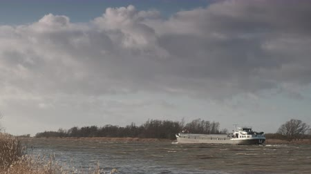 Ship sailing on the river IJssel during a windy day in Overijssel The Netherlands