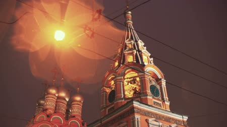 coppery : Bell-ringer at belfry of the old Russian church Stock Footage