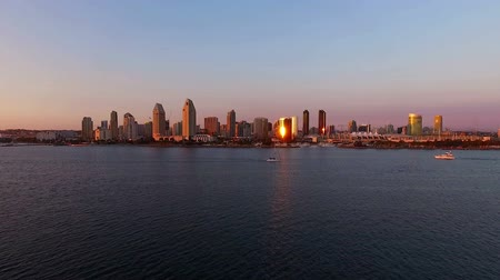 drone : This is a video taken with a drone in the late afternoon of the San Diego California skyline. The drone is moving over the water towards the city as it is going higher in the air.