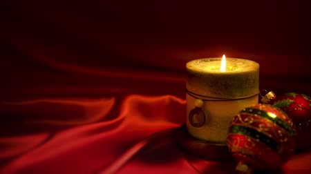 acetinado : This is a photo of Christmas candles and red ornaments with a lot of space for copy. Stock Footage