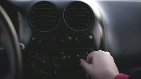 gomb : Hand pushes the car climate control button Stock mozgókép
