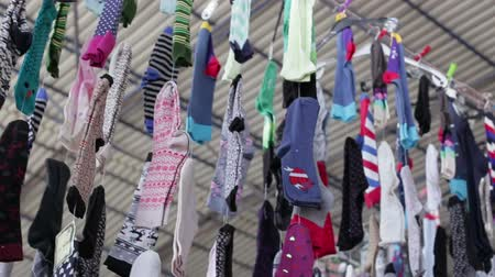 sock : Clothing market, socks hanging on the rope in the Turkish market in the summer