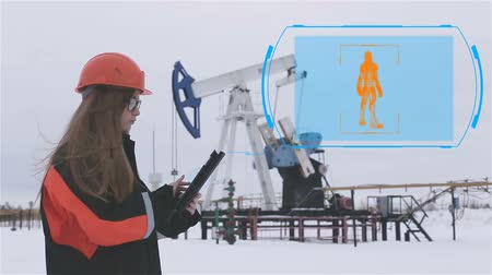 requiring : Woman engineer. A woman in a hard hat working in the oil field. Animation. Digital display. Oil production, Oil rocking chair in the background