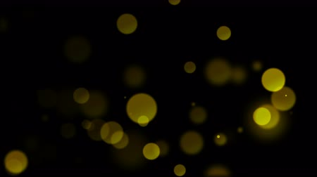 Animated abstract background with shiny yellow sequins. Smooth animation loop