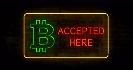 přijmout : Bitcoin accepted here neon lights on brick wall abstract background in seamless and loopable animation. Cryptocurrency symbol.