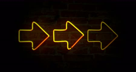 znak : Yellow arrows neon symbols on brick wall background. Glowing direction sign in seamless and loopable animation.