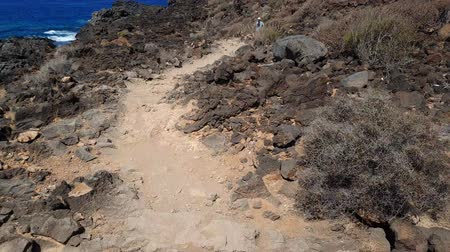 Low view of pathway on volcanic shore of Tenerife.