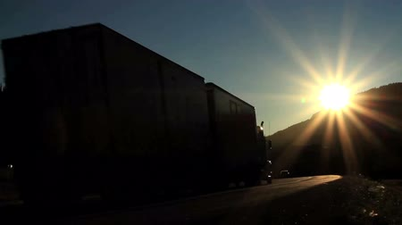 трейлер : Truck on Highway with Sun