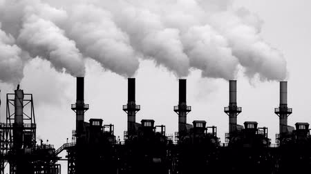 climate : Smoke stacks from a petrochemical plant Stock Footage