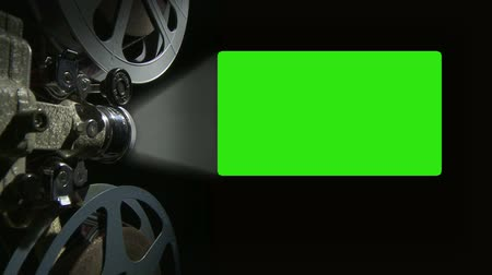 tuşları : Film Projector with 16x9 aspect ration green screen Stok Video