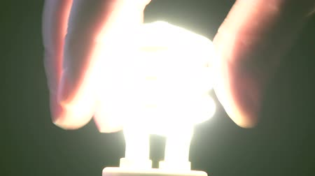 izzók : Man turning in new style light bulb