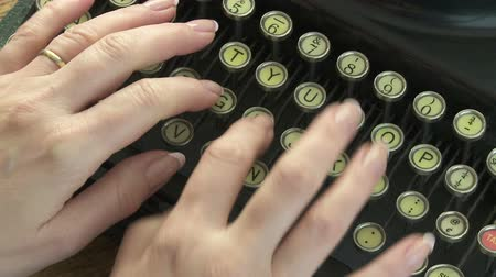 yazarak : Woman typing on antique typewriter