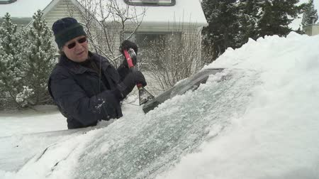 brushing : Scraping icy windshield
