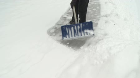 pěšina : Close up of shoveling snow