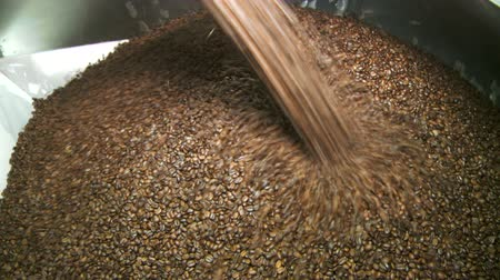 Roasted coffee beans exiting commercial size blender