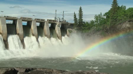 Rainbow on the Kananaskis Hydroelectric Dam spillway, Bow River, Alberta, Canada