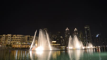 manmade : DUBAI, UAE - SEPTEMBER 10: Night view on Down town and Dancing fountains in Dubai city, on September 10, 2013, Dubai, UAE. In the city of artificial channel length of 3 kilometers along the Persian Gulf.
