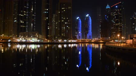 manmade : The night illumination of Dubai Marina. It is an artificial canal city, built along a two mile (3 km) stretch of Persian Gulf shoreline. Dubai, UAE
