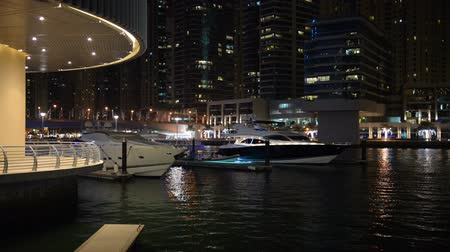 manmade : The night illumination of Dubai Marina and luxury yachts. It is an artificial canal city, built along a two mile (3 km) stretch of Persian Gulf shoreline. Dubai, UAE
