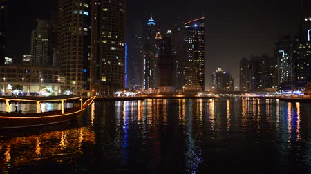 cayan tower : The night illumination of Dubai Marina and Dhow boat, UAE