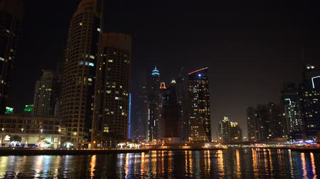 cayan tower : The night illumination of Dubai Marina, UAE Stock Footage