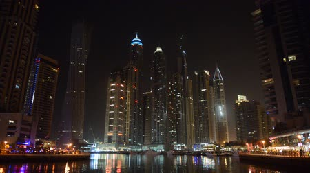 cayan tower : The night illumination of Dubai Marina. It is an artificial canal city, built along a two mile (3 km) stretch of Persian Gulf shoreline. Dubai, UAE