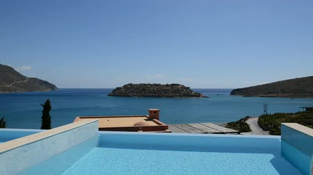 holiday villa : Swimming pool at luxury villa with view on Spinalonga island, Crete, Greece Stock Footage