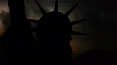 political intervention : International political, financial and economic crisis, world war, military, apocalypse concept. Loopable video. Silhouette of USA Statue of Liberty on dark background with flashing lightning storm.
