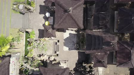 soul : Aerial view of Bali temple on green forest background. Scenic shot of ancient architecture in Indonesia. Tourist, religion and cultural concept Stock Footage