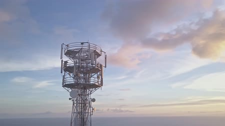 gsm : Aerial view of cell phone communication tower against blue sky. Scenic shot of world telecommunication concept. Stock Footage