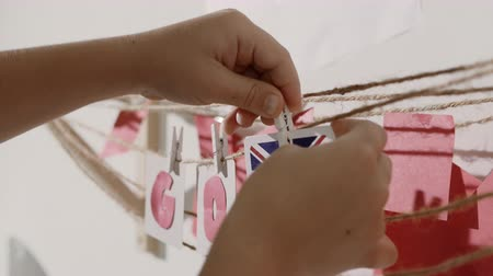oy : Go word collected by child hand from paper cards with red letters and flag of country Great Britain. Travel, motivation, sport, text message, business, language education concept.