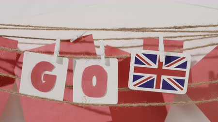 preocupar se : Go word collected by child hand from paper cards with red letters and flag of country Great Britain. Travel, motivation, sport, text message, business, language education concept.