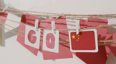 preocupar se : Go word collected by child hand from paper cards with red letters and flag of country China. Travel, motivation, sport, text message, business, language education concept.