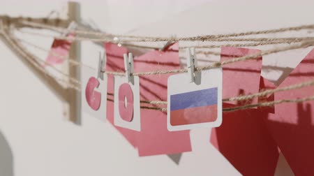 preocupar se : Go word collected by child hand from paper cards with red letters and flag of country Russia. Travel, motivation, sport, text message, business, language education concept. Vídeos